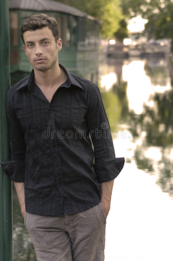 Download Guy Leaning On Pole Royalty Free Stock Photography - Image: 3144667