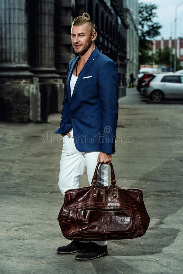 Guy with leather bag stock images