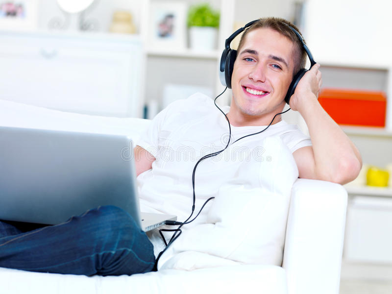 Download Guy Listening Music In Headphone From Laptop Stock Image - Image: 19802711