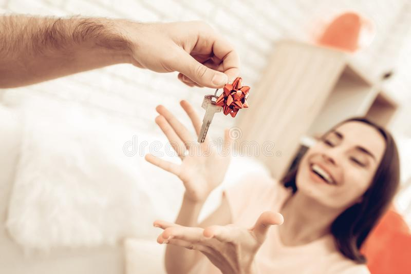 Guy Makes A Gift To Girlfriend On Valentine`s Day. royalty free stock photos