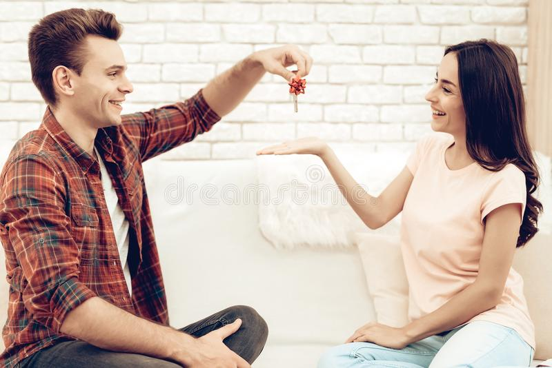 Guy Makes A Gift To Girlfriend On Valentine`s Day. stock image