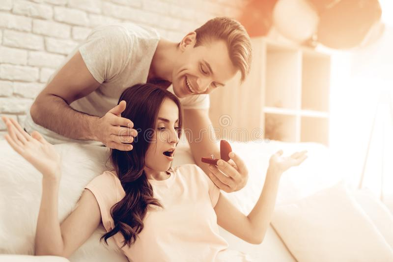 Guy Makes A Gift To Girlfriend On Valentine`s Day. Love Each Other. Sweetheart`s Romantic Moment Concept. Young And Handsome. Happy Relationship. Feelings royalty free stock image