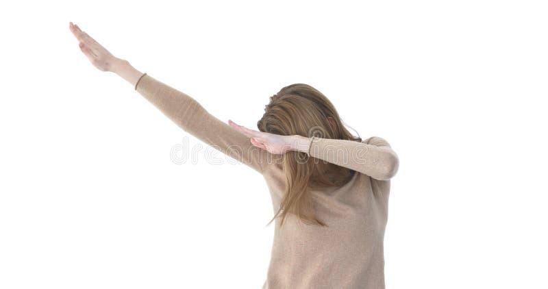 Guy making DAB dance. Young beautiful woman making DAB dance white wall background stock photos