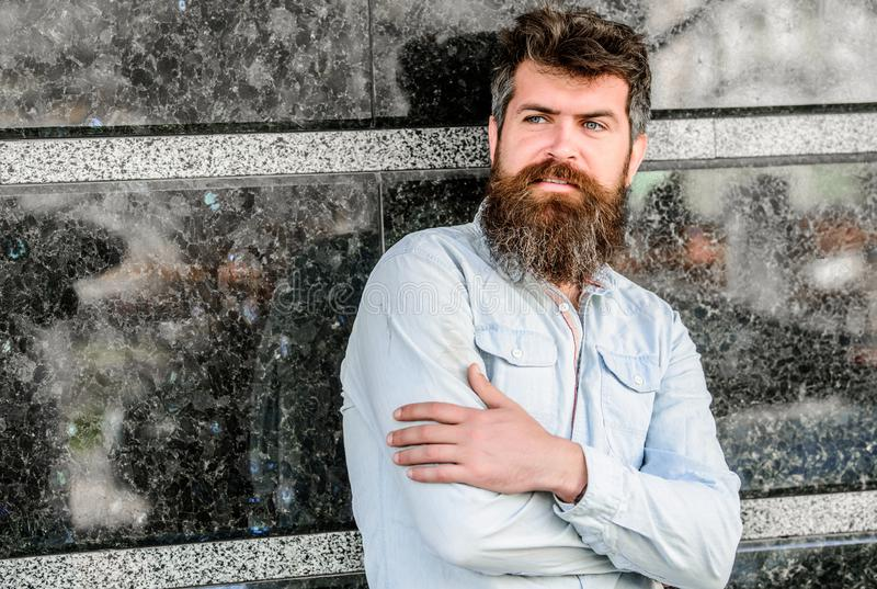 Guy masculine appearance with long beard. Barber concept. Beard grooming. Beard care. Man attractive bearded hipster royalty free stock images
