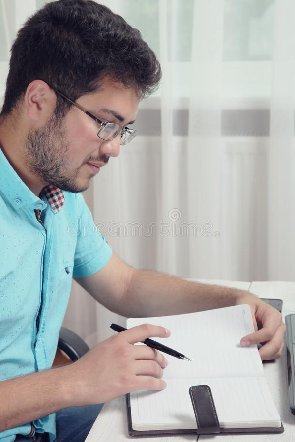 Guy with a notebook stock image