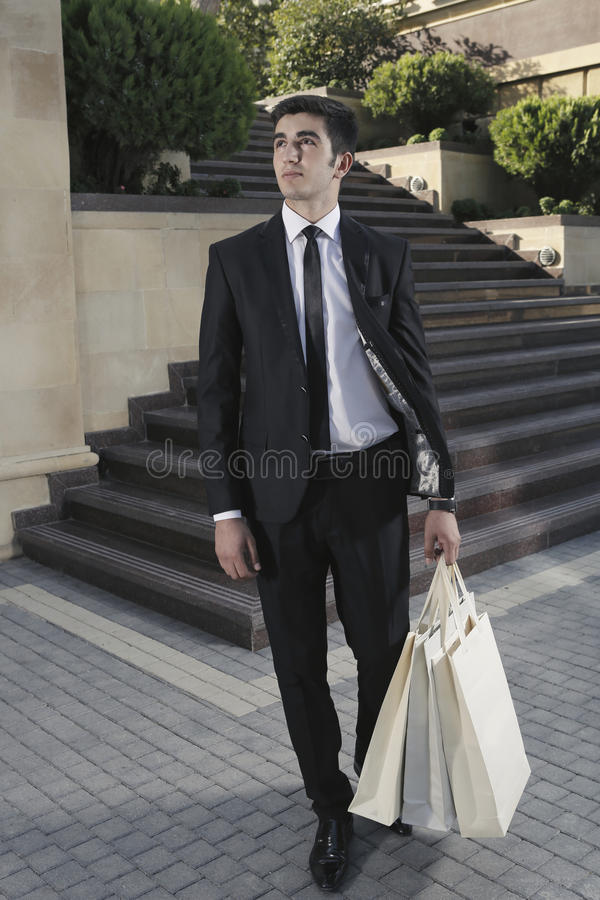 Guy with packages,shopping man stock photos