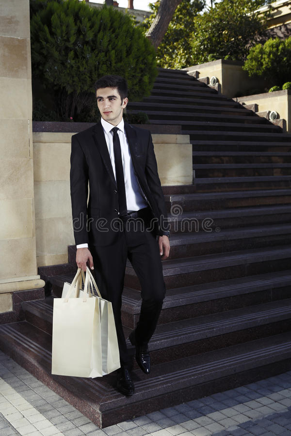 Guy with packages,shopping man stock image