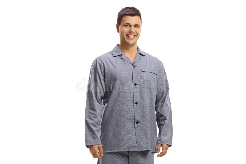 Guy in pajamas smiling royalty free stock image