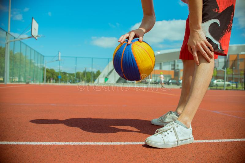 The guy on the playground plays basketball royalty free stock photo