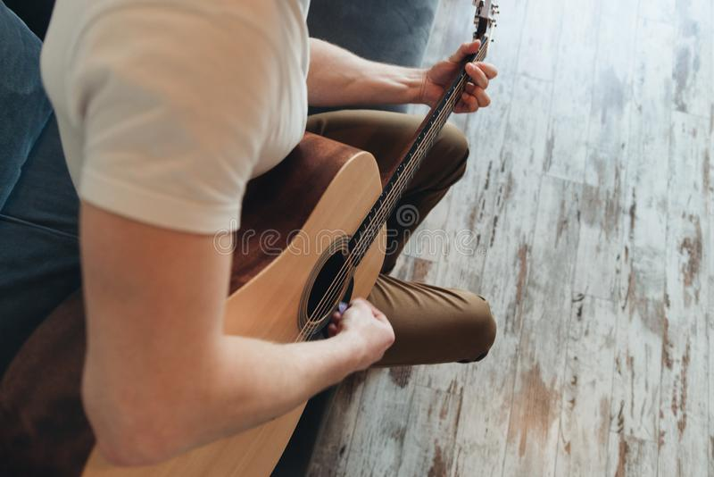 Smiling man playing guitar. Music concept royalty free stock photos