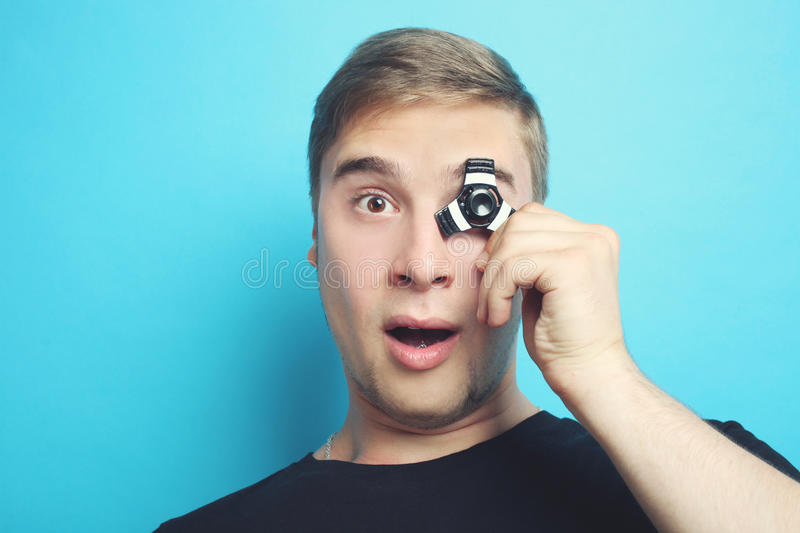 Spinner. The guy is playing with a spinner on a blue background stock photography