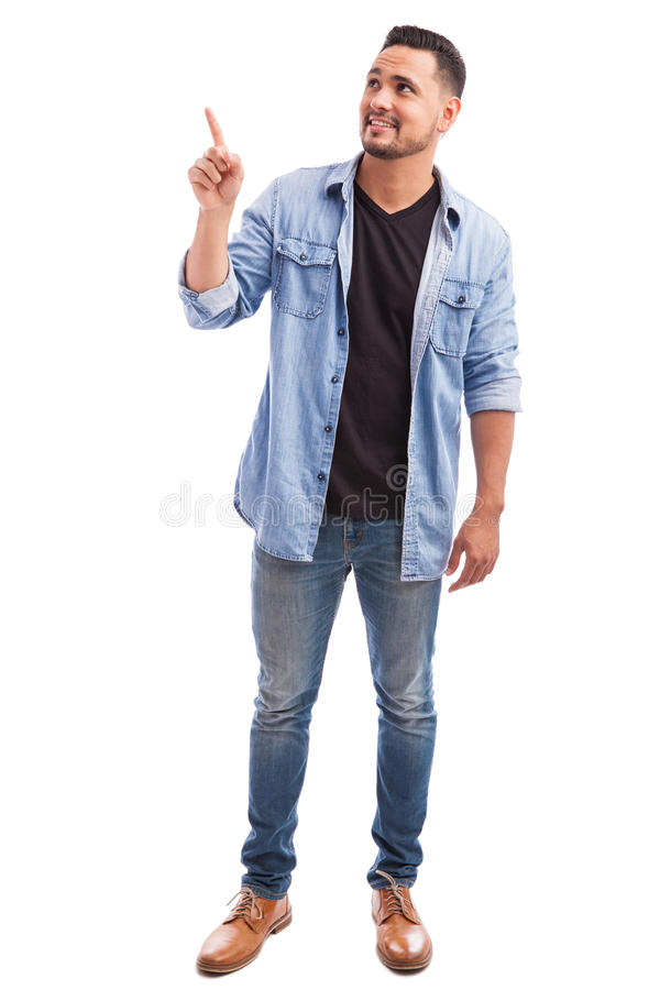 Guy pointing and looking up in a studio royalty free stock photos