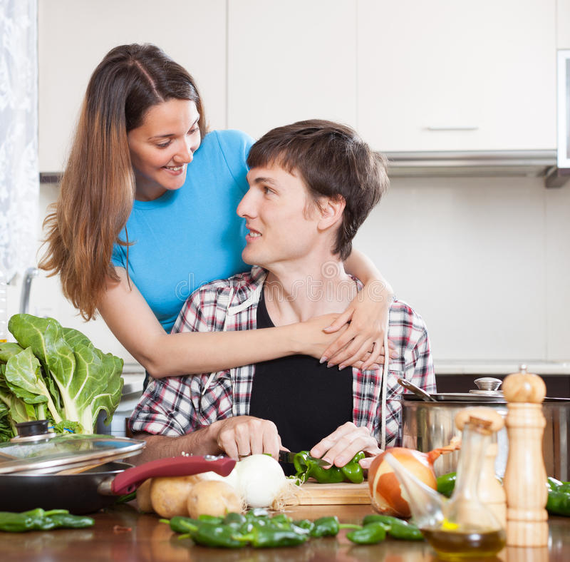 Download Guy And Pretty Girl Cooking In Domestic Kitchen Stock Photo - Image: 40183204