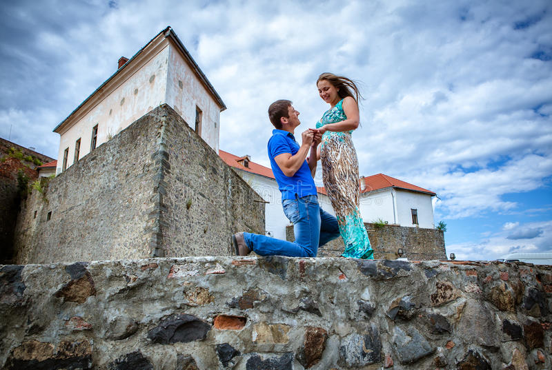 Guy proposing marriage to the girlfriend. Against the old lock stock photo