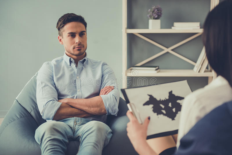 Guy at the psychologist stock photography