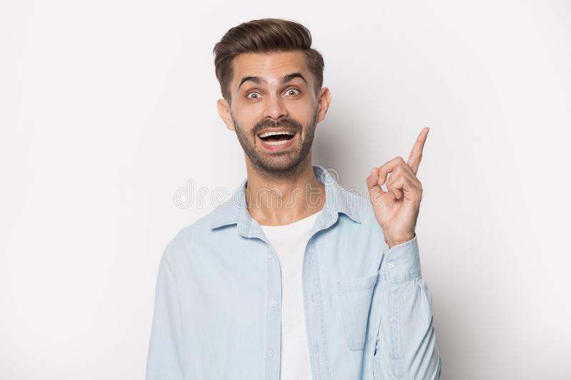Guy raised finger up gesture of resourceful person studio shot stock images