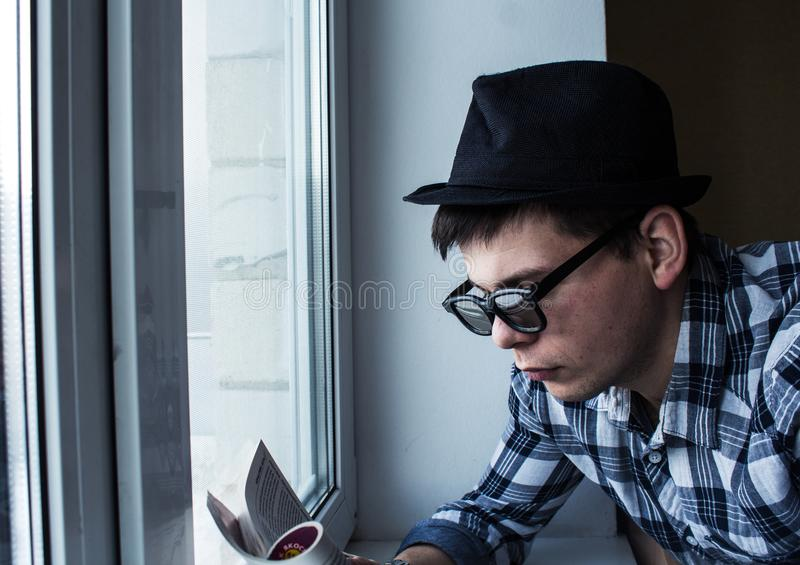 Guy is reading a magazine royalty free stock photos