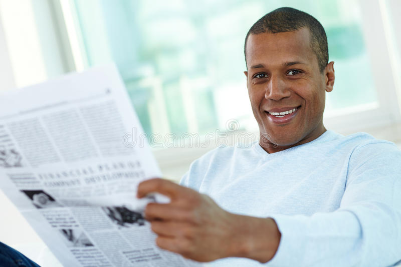 Guy reading newspaper royalty free stock images