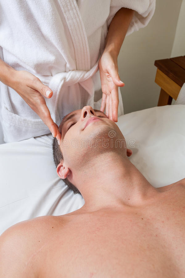 Guy receiving massage stock images