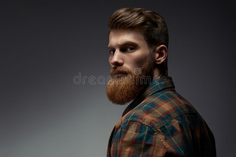 Guy with a red beard in a plaid shirt royalty free stock photography