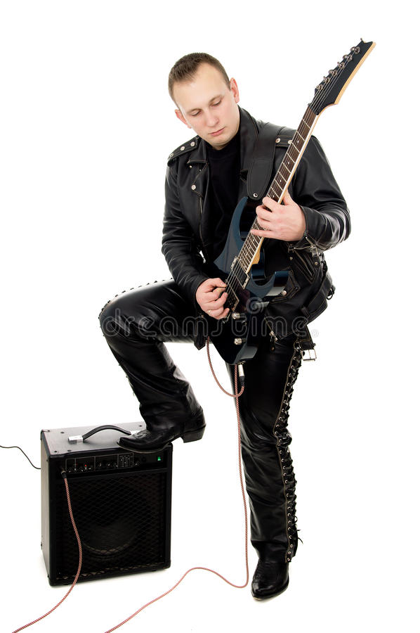 Guy rock guitarist in leather garments, plays guitar. Isolated on white background stock images