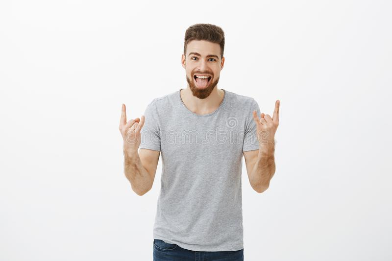 Guy rocking on party brings positive vibes. Carefree amazed and happy caucasian handsome charismatic male with beard royalty free stock image