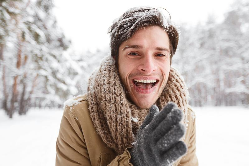 Guy Rubbing Hands To Warm Up Standing In Winter Forest stock photos