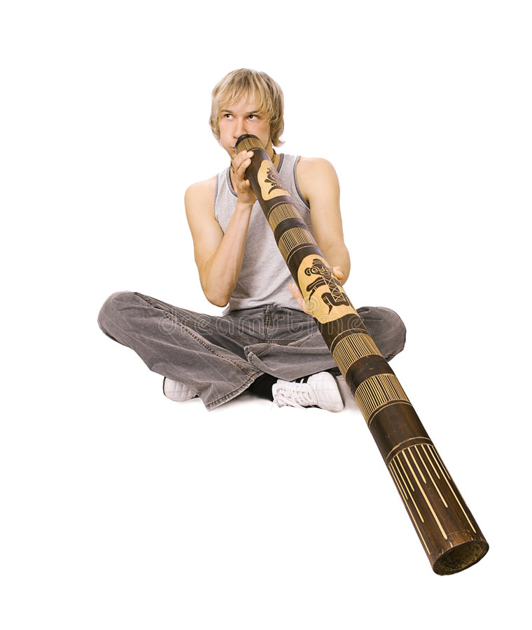Guy's playing didgeridoo royalty free stock images