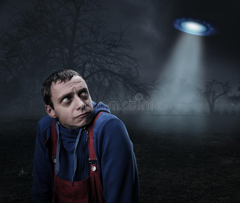 Guy scared by UFO. At night royalty free stock images