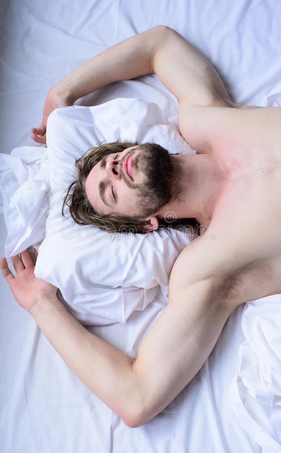Guy macho lay white bedclothes. Man sleepy unshaven bearded face sleep has rest. Pleasant dream concept. Let your. Body feel comfortable. Man unshaven handsome royalty free stock images