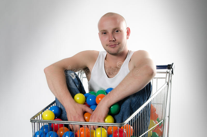 Guy In Shopping Cart Royalty Free Stock Image