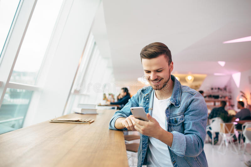 Guy is sitting in front of the table near window stock images