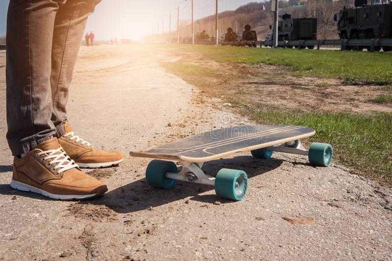 A guy with a skateboard. On a sunny summer day royalty free stock images