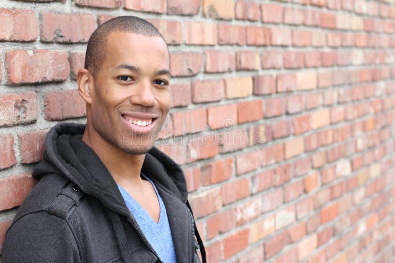 Guy Smiling amichevole etnico felice con lo spazio della copia fotografia stock