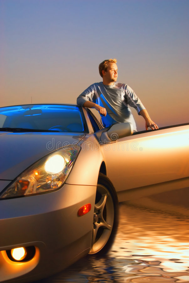 Guy with a sport car royalty free stock photography