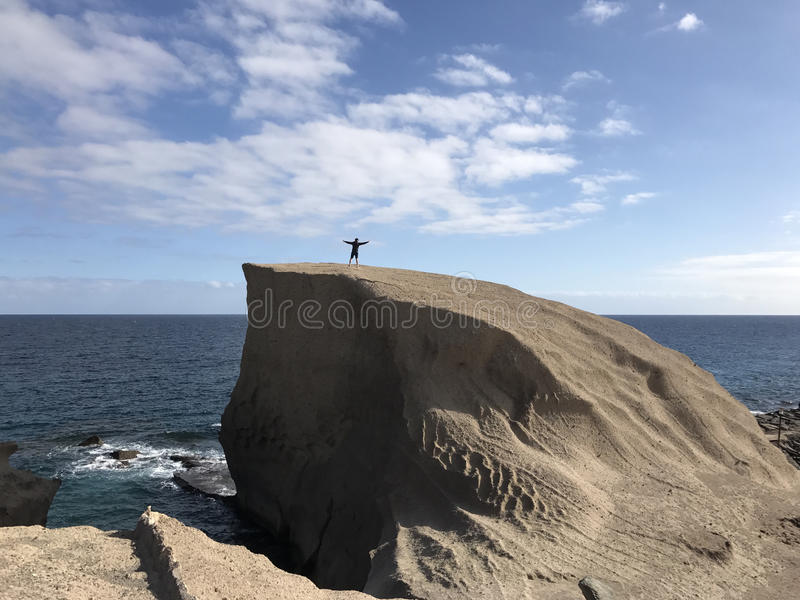 Guy stands on a big. Rock at San Miguel de Tajao in Tenerife stock images