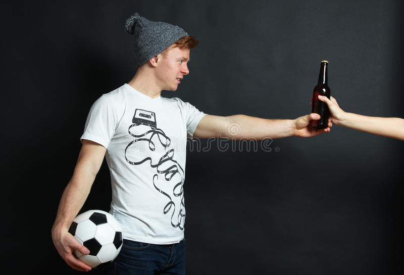 The guy takes beer bottle royalty free stock photos