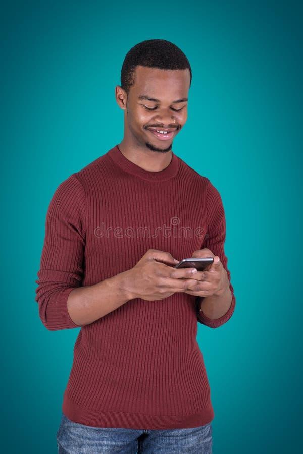 Guy Using Smart Phone preto imagens de stock