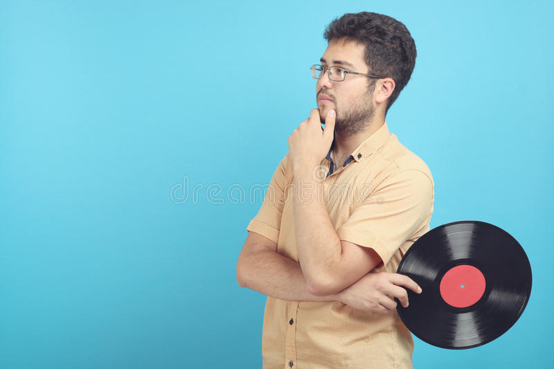 Guy with a vinyl record. A guy with a vinyl record on a blue background royalty free stock images