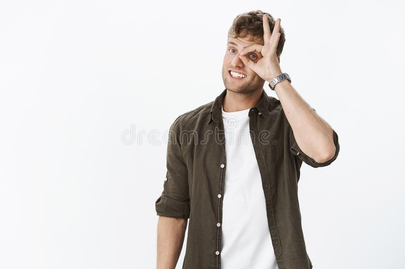 Guy watching you. Friendly and cute funny boyfriend with blond hair and bristle showing okay gesture, no problem, making stock images