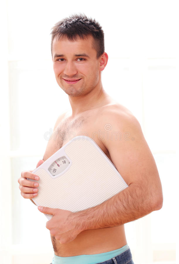 Download Guy with weight scales stock image. Image of health, natural - 25688033