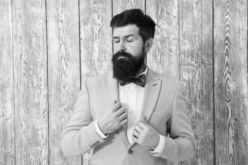 Guy well groomed handsome bearded hipster wear tuxedo. Romantic wedding outfit. Gentleman style barber. Barber shop stock photo
