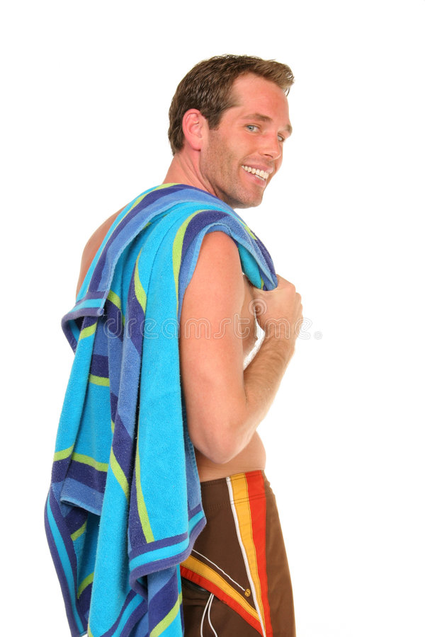 Guy on white. Guy holding beach towel in swim trunks on white backdrop stock photos