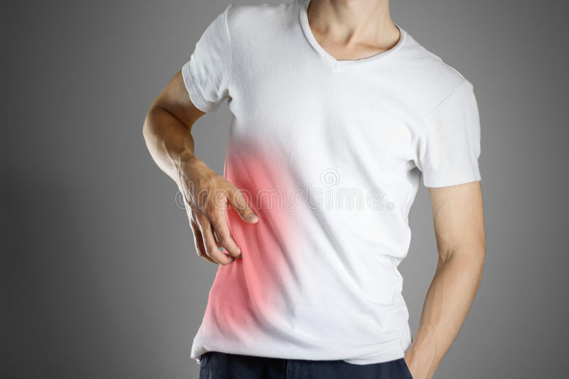 Guy in white shirt scratching his body. Scabies. Scratch the bod royalty free stock photography