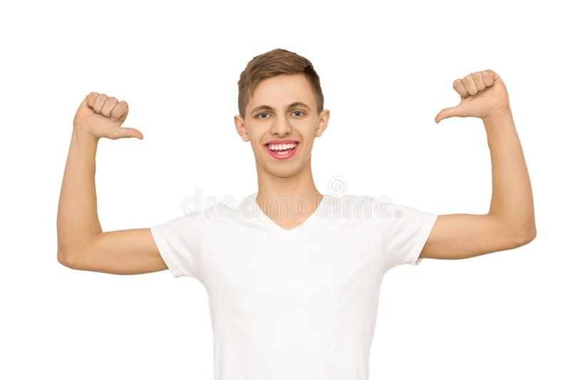 A guy in a white T-shirt with his hands up in the studio, isolate stock images