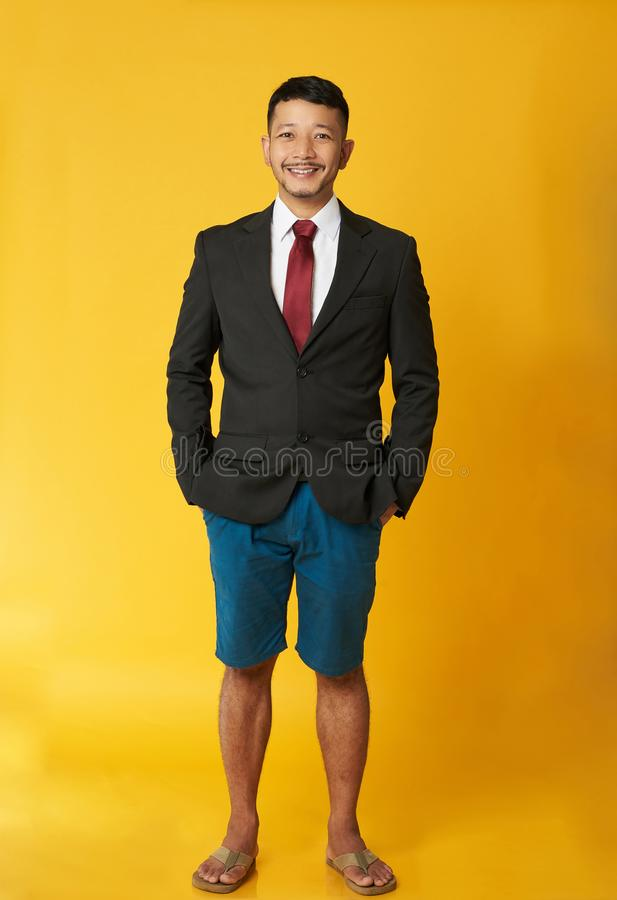 Free Guy With Coat And Beach Shorts Stock Photo - 145370440