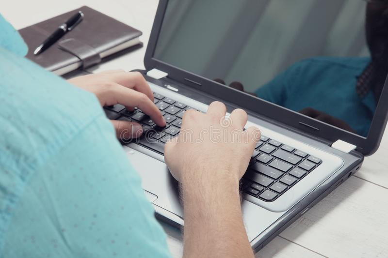 Guy is working behind the laptop royalty free stock photography