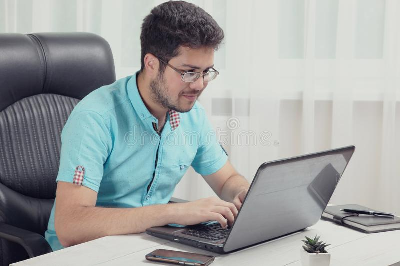 Guy is working behind the laptop royalty free stock images