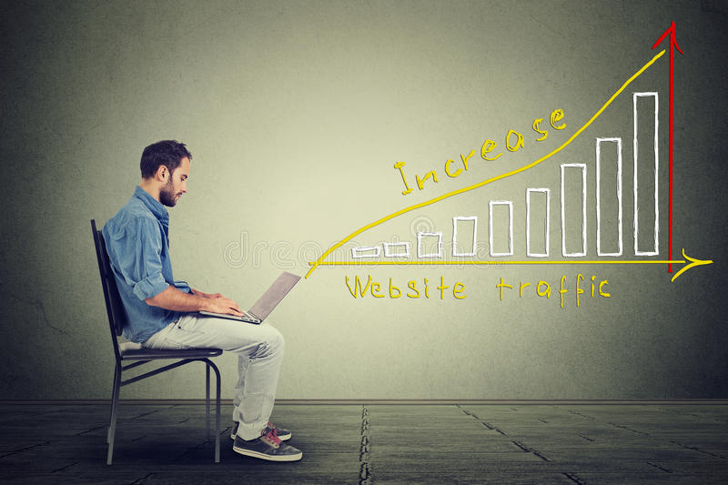 IT guy young man working on notebook has a plan to increase website traffic. royalty free stock image