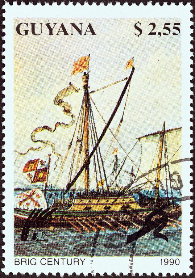 GUYANA - CIRCA 1990: A stamp printed in Guyana from the `Sailing Ships` issue shows Brig Century, circa 1990. GUYANA - CIRCA 1990: A stamp printed in Guyana stock photo